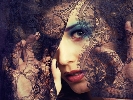 mistery: portrait of beauty young woman through black lace close up mistery fairy makeup