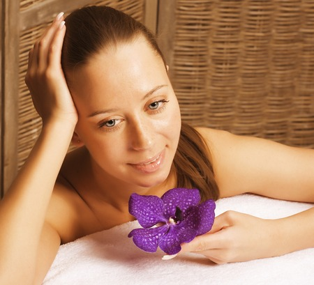 keep an eye on: beauty young woman with flower close up getting spa