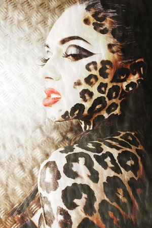 bodyart: young sexy woman with leopard print make up all over body, cat bodyart closeup