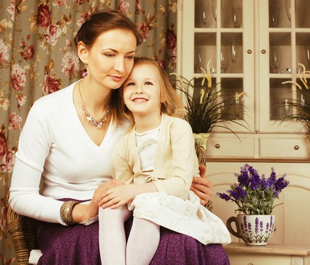 3 4 years: young mother with daughter at home white bright interior rich