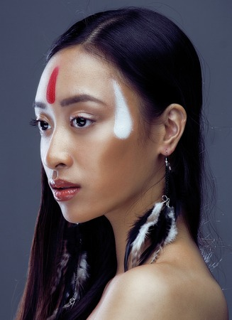 pocahontas: beauty young asian girl with make up like Pocahontas, red indians woman fashion, close up beauty stylish look Stock Photo