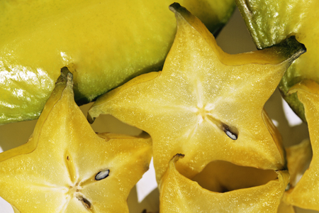 close up food: delicious carambola asian exotic fruit on white background isolated close up, food in asia Stock Photo
