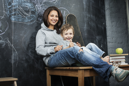 diverse family: young hipster teenage girl sitting with her brother in classroom multinational, diverse family Stock Photo