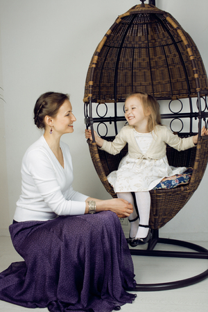3 4 years: young mother with daughter at luxury home interior vintage hipster happy smiling family Stock Photo
