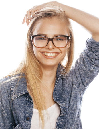 blonde teenage girl: young pretty girl teenager in glasses on white isolated blond hair modern hipster smiling. lifestyle concept