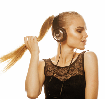 young sweet talented blond teenage girl in headphones singing isolated