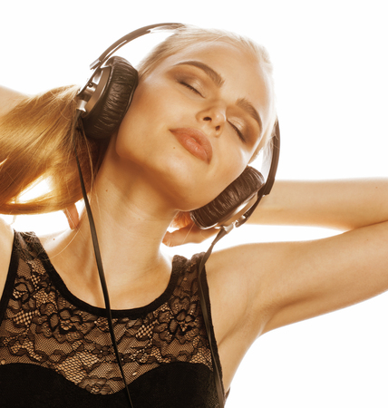 talented: young sweet talented blond teenage girl in headphones singing isolated