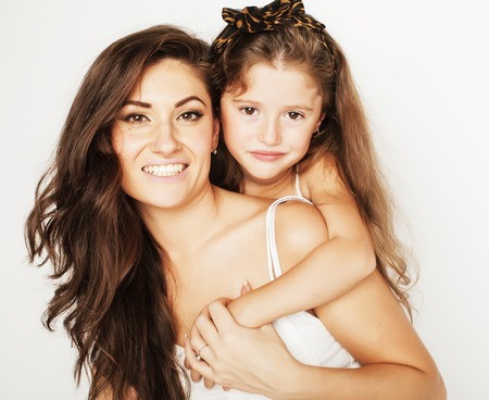 stylish woman: bright picture of hugging mother and daughter happy together, smiling stylish family. girls aloud