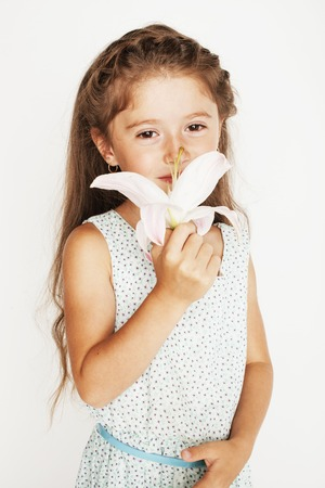 glamur: little cute spring girl with lily flower in fancy dress isolated on white background, glamur fairy
