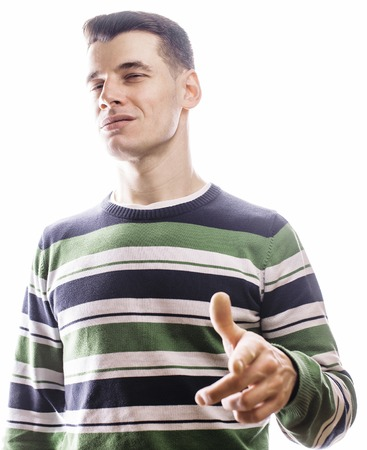 corrugation: Portrait of a smart serious young man standing against white background. Emotional concept for gesture, making faces