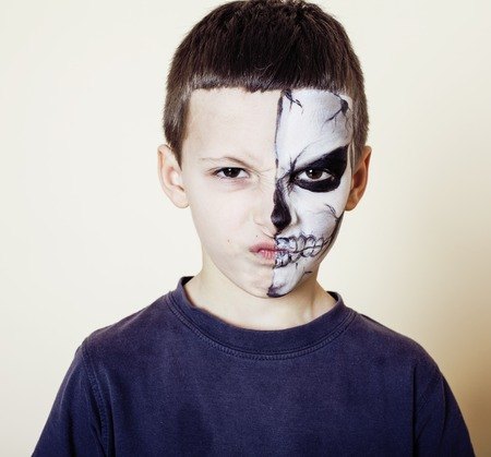 little cute boy with facepaint like skeleton to celebrate halloween close up makeup Stock Photo