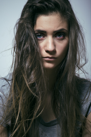 messed: problem depressioned sad teenage with messed hair and sad face, real junky close up