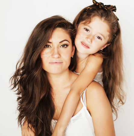 mum and daughter: bright picture of hugging mother and daughter happy together, smiling stylish family. girls aloud