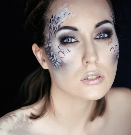 animal sex: fashion portrait of pretty young woman with creative make up like a snake print, fashion victim with python skin clutch luxury
