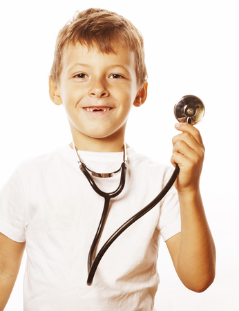 stethoscope boy: little cute boy with stethoscope playing like adult profession doctor close up smiling isolated on white background