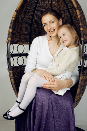 3 4 years: young mother with daughter at luxury home interior vintage, old fashion relashionship family