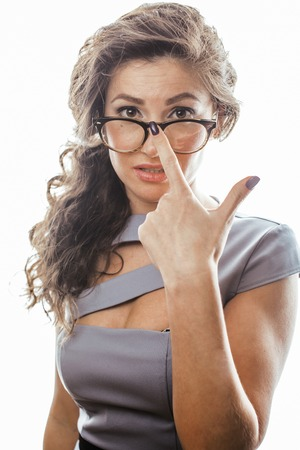 sexy secretary: young pretty real brunette woman secretary in sexy dress wearing glasses isolated on white background pointing gesturing emotional cheerful lady, businesswoman concept