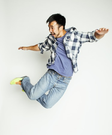 students fun: young pretty asian man jumping cheerful against white background, lifestyle people concept, supeman flying Stock Photo