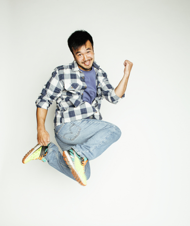 man flying: young pretty asian man jumping cheerful against white background, lifestyle people concept, supeman flying Stock Photo
