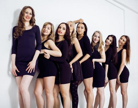 Many diverse women in line, wearing fancy little black dresses, party makeup, vice squad concept hot Standard-Bild