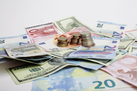 global crisis: Cash on table isolated: dollars, euro, rubl broken money. All in mess, global crisis concept close up Stock Photo