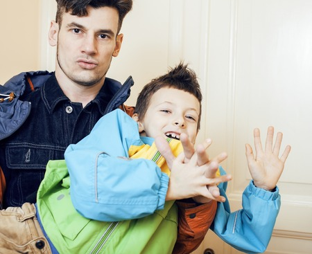 fooling: young handsome father with his son fooling around at home, lifestyle people concept close up