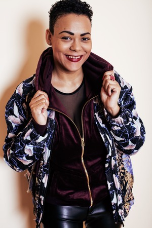 mulatto woman: young pretty mulatto woman with modern haircut fancy dressed, posing smiling, fashion concept Stock Photo