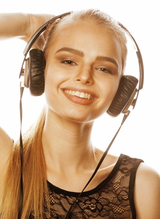 talented: young sweet talented teenage girl in headphones singing isolated on white background