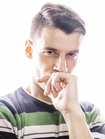 corrugation: Portrait of a smart serious young man standing against white background. Emotional concept for gesture, lifestyle people concept Stock Photo