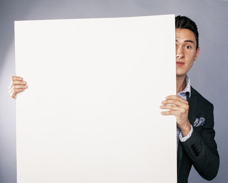 handsom: young handsom businessman in suit with poster empty copy space smiling, lifestyle advertising people concept