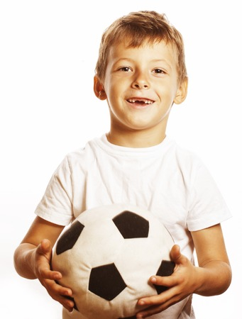 normal school: little cute boy playing football ball isolated on white background close up catching moove