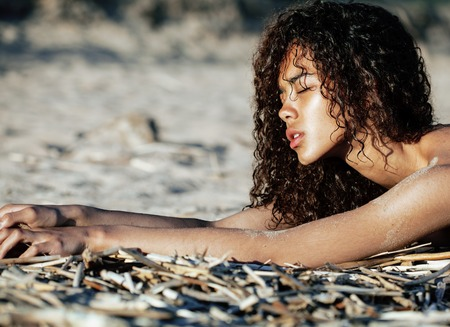 asian bikini: young pretty girl asian face curly hairstyle at beach, vacation tann Stock Photo