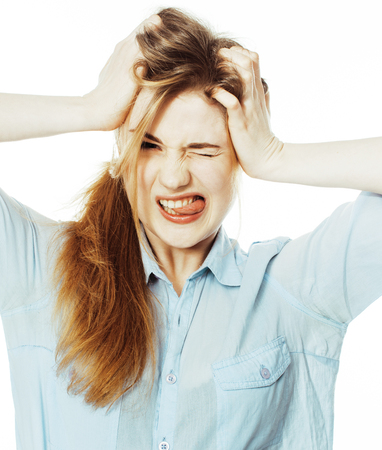 messed: cute young woman making cheerful faces on white background, messed hair isolated close up Stock Photo