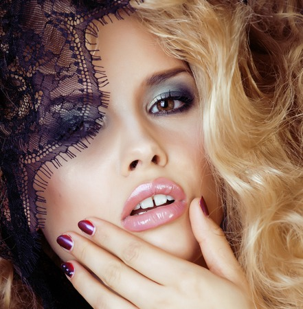 seduction: Portrait of beauty blond young woman through black lace close up sensual seduction, hairstyle waves