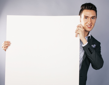handsom: young handsom businessman in suit with poster empty copy space smiling, business people concept Stock Photo