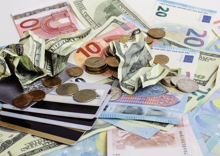 global crisis: Cash on table isolated: dollars, euro, rubl broken money. All in mess, global crisis concept, dollar rules world
