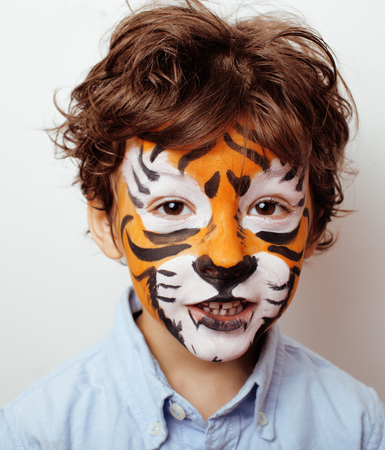 faceart: little cute boy with faceart on birthday party close up, little cute orange tiger