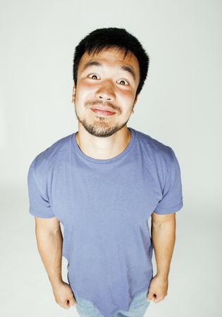 funy: young cute asian man on white background gesturing emotional, pointing, smiling, lifestyle people concept, cheerfull mature guy making funy faces