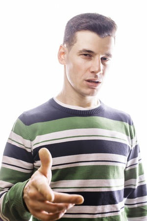 corrugation: Portrait of a smart serious young man standing against white background. Emotional concept for gesture close up Stock Photo