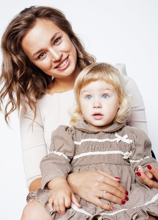 funy: young pretty stylish mother with little cute blond daughter hugging, happy smiling real family, lifestyle people concept