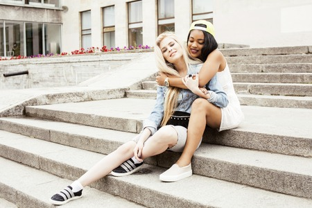 multy: cute group of teenages at the building of university with books huggings, back to school, lifestyle happy real people concept, students at summer smiling