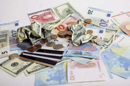 global crisis: Cash on table isolated: dollars, euro, rubl broken money. All in mess, global crisis concept