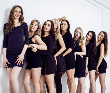 sexual selection: Many diverse women in line, wearing fancy little black dresses, party makeup, vice squad concept, lifestyle business people in a row