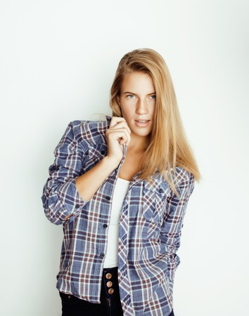 frendly: young pretty blond girl hipster posing frendly against white background wall, smiling woman with long hair close up