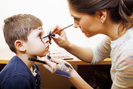 Little Cute Child Making Facepaint On Birthday Party Zombie