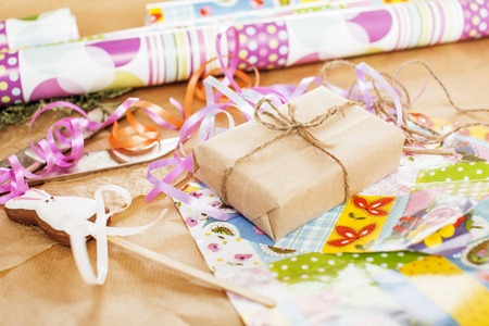 lot of stuff for handmade designed gifts, scissors, ribbon, paper with countryside pattern, ready for holiday concept, nobody home