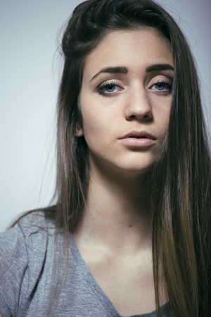 junky: problem depressioned teenage with messed hair and sad face, real junky bad looking girl close up, fooling around Stock Photo