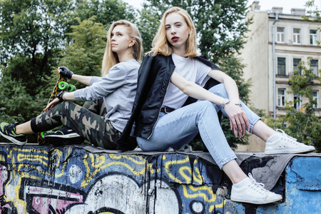 normal school: two blonde real teenage girl hanging out at summer together best friends, lifestyle people concept problem Stock Photo
