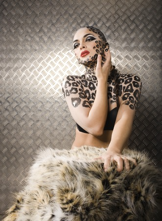 bodyart: young sexy woman with leopard make up all over body, cat bodyart print closeup sensual