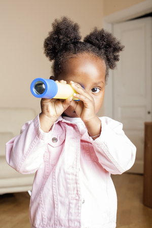 litle: litle cute sweet african-american girl playing happy with toys at home, lifestyle children concept close up Stock Photo